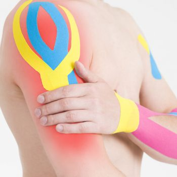 Kinesio tape, kinesiology taping on human hand